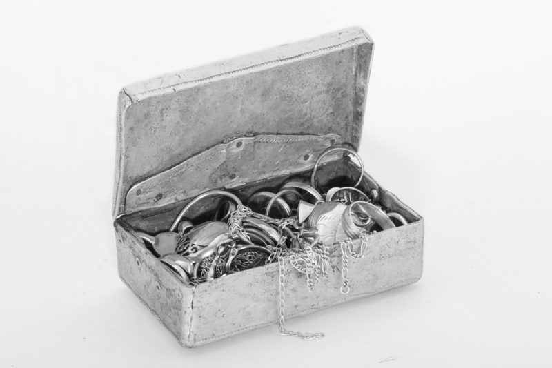 jewelry box filled with silver   Sterling Silver Jewelry vs. Pure Silver: What's The Difference?