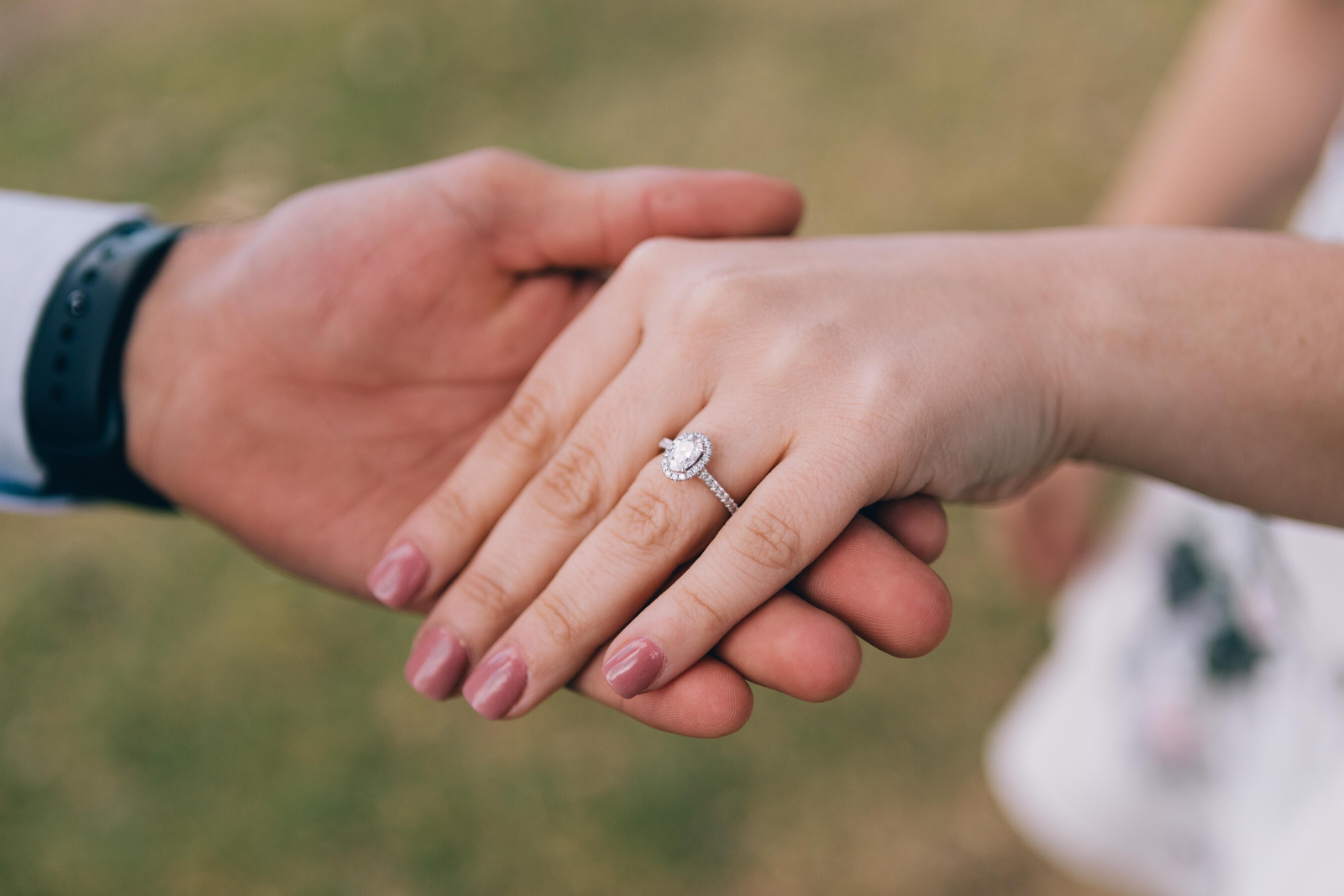 Man Holding Woman's Hand | 5 Key Differences Between Cubic Zirconia And Diamond