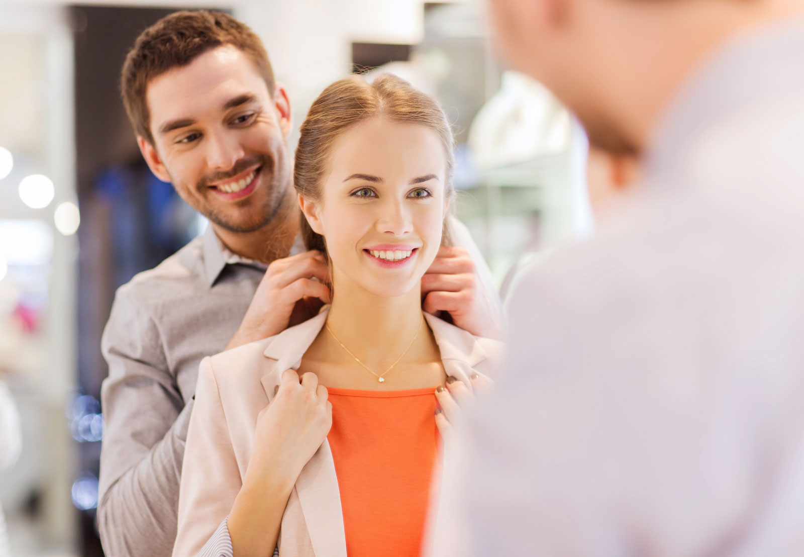 Man Putting Necklace on Woman   How To Pick Out The Best Jewelry Gifts For A Loved One