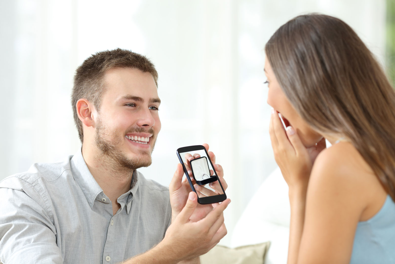 Man Showing a Ring To a Woman | 6 Things To Look For From A Good Online Jewelry Store