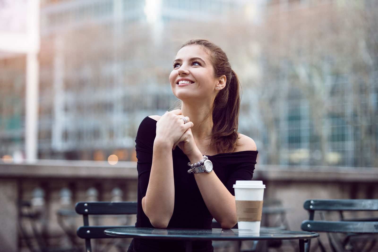 Woman Sitting With Table | 6 Tips For Picking The Best Affordable Women's Watch