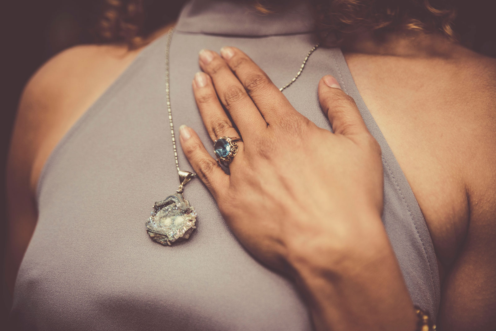 Woman Showing Her Necklace | How Fake Jewelry Gives Fashion Jewelry A Bad Name