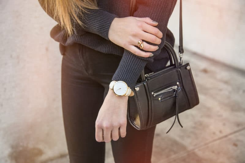 woman wearing wrist watch | 10 Best Jewelry Fashion Blogs For Affordable Style Tips