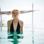 Woman in Swimming Pool | Is Waterproof Jewelry Really Reliable To Wear In Water?